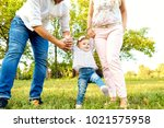 the first steps of the baby.... | Shutterstock . vector #1021575958