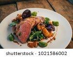 ros  duck breast with broccoli... | Shutterstock . vector #1021586002