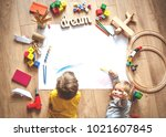 kids drawing on floor on paper. ... | Shutterstock . vector #1021607845