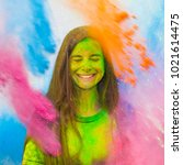 happy holi. young cheerful girl ... | Shutterstock . vector #1021614475