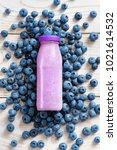 blueberry around bottle of... | Shutterstock . vector #1021614532