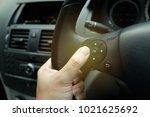 hand gripping steering wheel...   Shutterstock . vector #1021625692