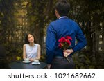 man is hiding flowers behind... | Shutterstock . vector #1021682662