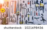 old tools hanging on wall in...   Shutterstock . vector #1021698436