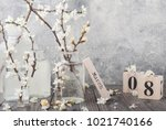 Small photo of 8 March. Blossoms (apple tree flowers) in vases on grey wooden table. Flowers composition. Spring blooming. Blossom branches.