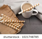 chocolate wafer sticks and cup... | Shutterstock . vector #1021748785