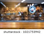 empty wooden table blurred cafe ... | Shutterstock . vector #1021753942