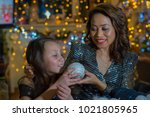 mother and daughter in the home ... | Shutterstock . vector #1021805965