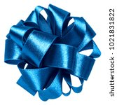 Small photo of Shiny satin ribbon bow in blue color isolated on white background close up