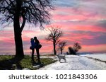 lovers under the pink sky | Shutterstock . vector #1021843306