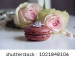 diamond ring on macaron and... | Shutterstock . vector #1021848106