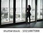 beautiful woman looking at city ... | Shutterstock . vector #1021887088