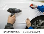 car wrapping specialist putting ... | Shutterstock . vector #1021913695