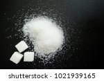 sugar on black background. | Shutterstock . vector #1021939165