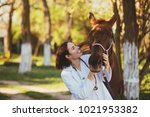 veterinarian enjoying with a... | Shutterstock . vector #1021953382
