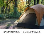 tent on campsite in early... | Shutterstock . vector #1021959616