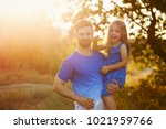family time. the father holds...   Shutterstock . vector #1021959766