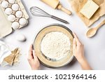Small photo of Hand sift flour. Bakery prepare for make cake. Top view