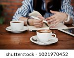 women working and drinking... | Shutterstock . vector #1021970452