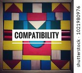 Small photo of Inspirational word - 'Compatibility' word on colorful wooden toy blocks as background.