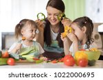 happy family mom and her kids... | Shutterstock . vector #1022000695