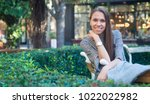 smiling happy woman sitting on... | Shutterstock . vector #1022022982