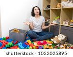 young mother cleaning her kid's ... | Shutterstock . vector #1022025895