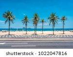 Small photo of Palms on Ipanema Beach with blue sky, Rio de Janeiro, Brazil.