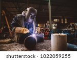 welder in protective uniform... | Shutterstock . vector #1022059255