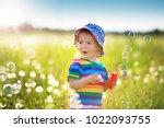 happy baby boy standing in... | Shutterstock . vector #1022093755