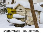 a pair of snow covered bee... | Shutterstock . vector #1022094082