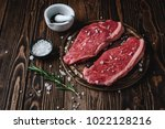 two raw picanha steaks  on a... | Shutterstock . vector #1022128216
