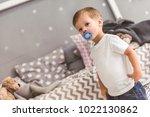 cute little boy with a pacifier ... | Shutterstock . vector #1022130862