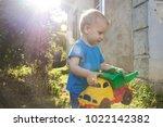 a little boy in a blue t shirt... | Shutterstock . vector #1022142382
