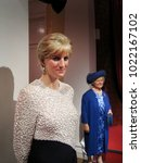 Small photo of London, England - April 24, 2008. Diana, Princess of Wales wax figure (Left) and Queen Elizabeth II at the background inside the Madame Tussauds wax museum.