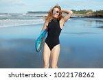 happy relaxed female in black... | Shutterstock . vector #1022178262