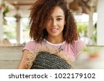 close up shot of curly young... | Shutterstock . vector #1022179102