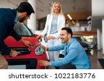 young couple choosing new car...   Shutterstock . vector #1022183776