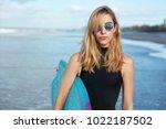 good looking blonde young woman ... | Shutterstock . vector #1022187502