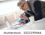 architect in office talking on... | Shutterstock . vector #1022190466