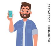 man is showing the phone.... | Shutterstock .eps vector #1022191912