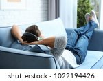 relaxed young man listening to... | Shutterstock . vector #1022194426