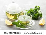 cup of tea with mint leafs and... | Shutterstock . vector #1022221288