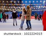 ice skating rink and lovers... | Shutterstock . vector #1022224315