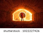 a man in a red hood opened a... | Shutterstock . vector #1022227426