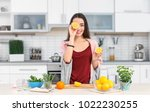 young woman preparing tasty... | Shutterstock . vector #1022230255