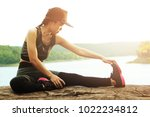 healthy young woman exercising... | Shutterstock . vector #1022234812