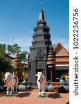 Small photo of Siem Reap Cambodia, Statue of bullocks in front of stupa at the 14th century Wat Preah Prom Rath