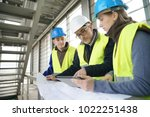 construction site manager with... | Shutterstock . vector #1022251438