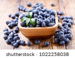 bowl of fresh blueberries on... | Shutterstock . vector #1022258038
